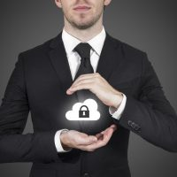 28818787 - businessman protect cloud lock symbol with hands